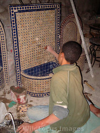 Modern mosaic fountain being made, Fes, Morocco; Portrait
