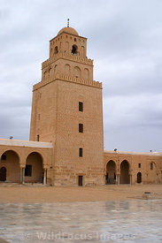 A three tiered minaret at the northern end of the courtyard of the Grand Mosque. The bottom tier was built in 728 AD. Kairouan, Tunisia; Portrait