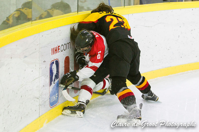 Strong defensive tactics by Germany's no 23 Pia Clauberg against Austrian no 6 Laura Kraus.