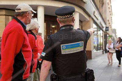 Saferglasgow Community Enforcement Officer assisting member of the public