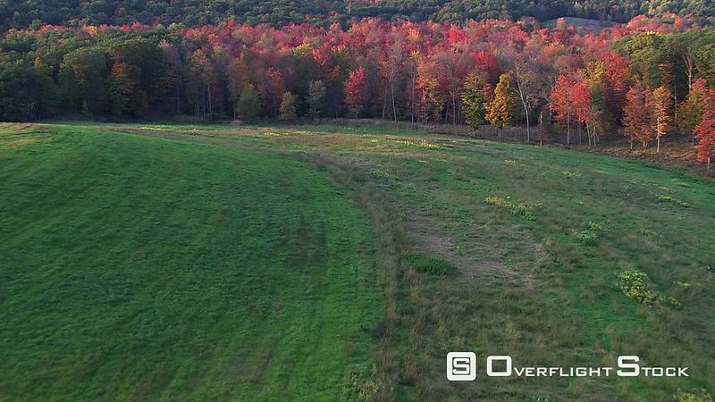 Flight over rural New England landscape in autumn