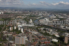 Manchester aerial photograph of Eccles town centre with the Manchester Ship Canal running around the north side of Trafford Park Estate with Media City and Salford Quays with the Pennines in the distance