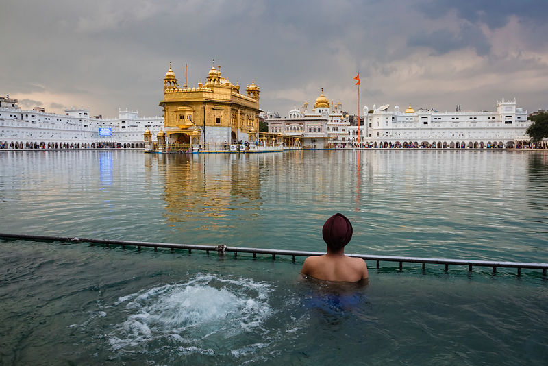 A Sikh Prays at the Source of the holy Pool around the Golden Temple