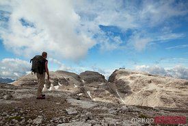 Hiker admiring the mountain panorama Dolomites Italy