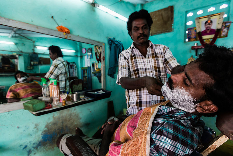 Man Getting a Shave at a Barber Shop.