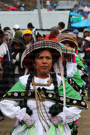 Female contradanza dancer performing in front of Sanctuary during Qoyllur Riti festival, Peru