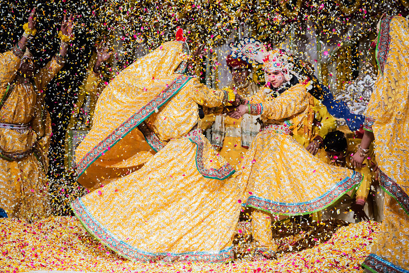 Performers Playing Holi with Flower Petals