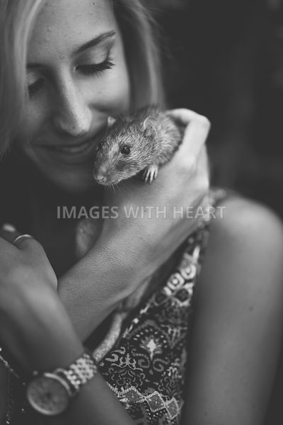 B+W woman cuddling rat
