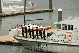Officers and Crew of HMS Puncher (P291) taking the salute.