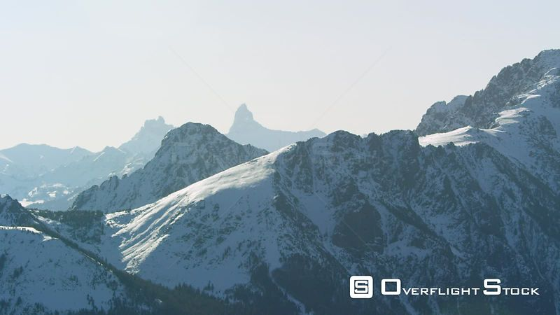 Pilot Peak towers over the snowcoverd peaks and steep cliffs of the Beartooth mountain Range, near Yellowstone Nataional Park