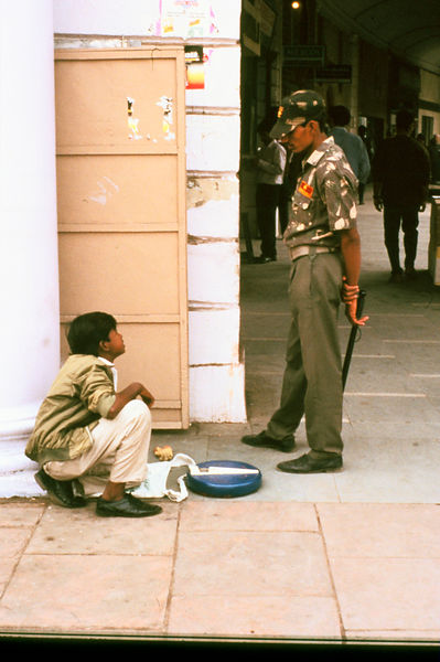 India - Delhi - A shoe shine boy at work