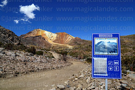 Tourist information sign next to dirt track below Tunupa volcano, Oruro Department, Bolivia