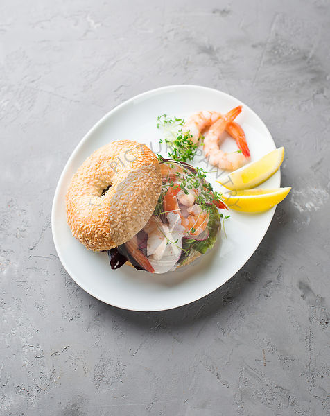 Bagel with shrimp and radish