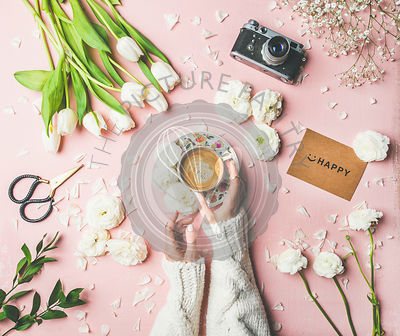 Spring layout with Coffee in female hands, flowers, sign happy