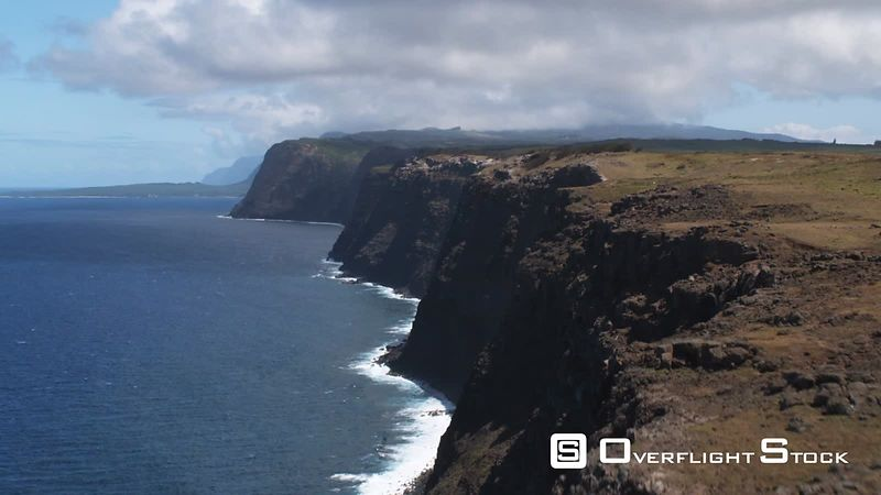 Flying along the cliffs of Molokai's coastline.