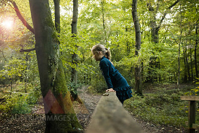 Girl playing in forest