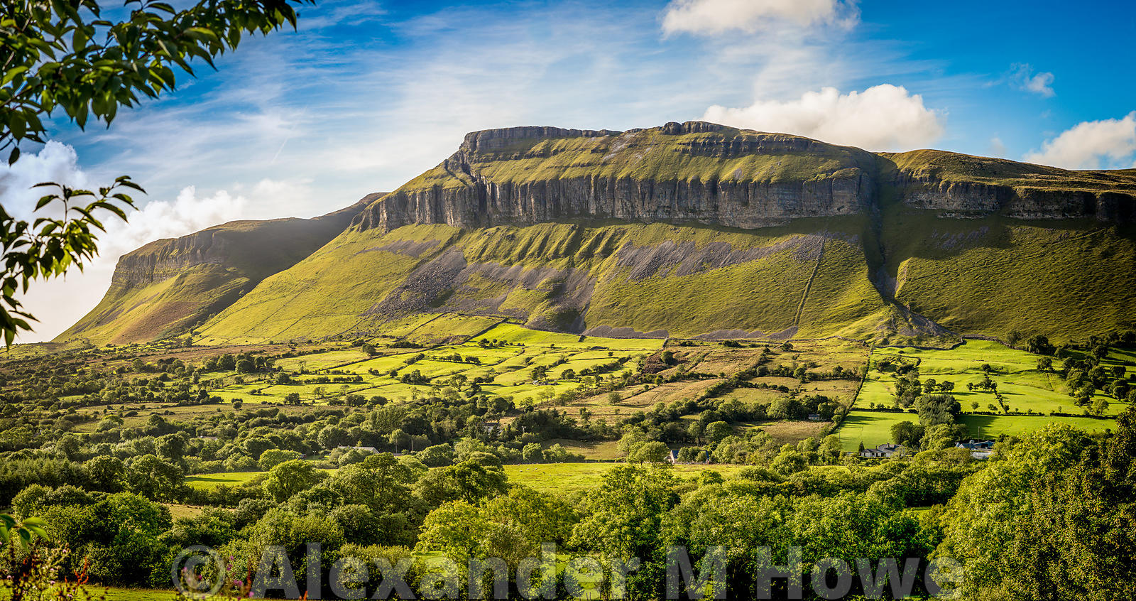 Part of the Dartry Mountains in County Sligo surrounded by lush pasture and tress