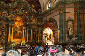 Crowds inside Las Nazarenas church during Señor de los Milagros festival, Lima, Peru