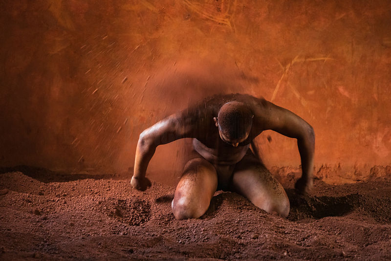 Portrait of a Kushti Wrestler Applying Sand to his Body to keep Cool and to Absorb the Sweat