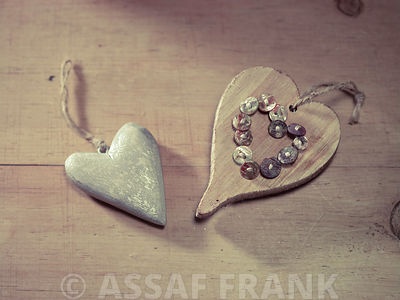 Two wooden hearts on a table