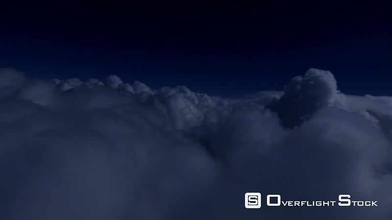 Teetering night flight over clouds
