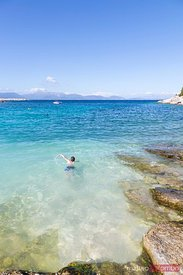 Boy swimming in the blue mediterranean sea, Greece