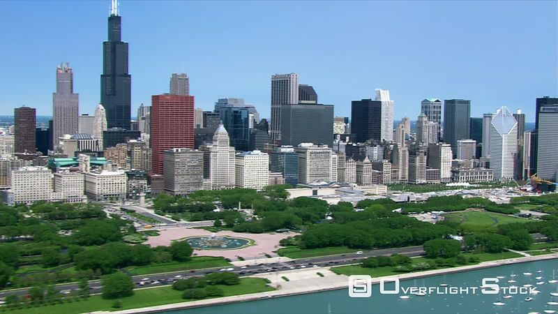 Chicago skyline viewed from flight along lakeshore.