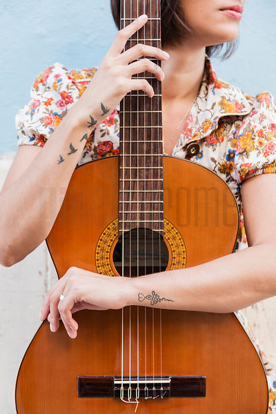 Musician Holding Guitar in Front of her Body