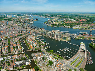 Amsterdam, the Oosterdok and Oosterdoks Island (Oosterdokseiland)(ODE),  the Amsterdam Centraal Railway Station (Amsterdam CS) and the river IJ. Amsterdam, Netherlands