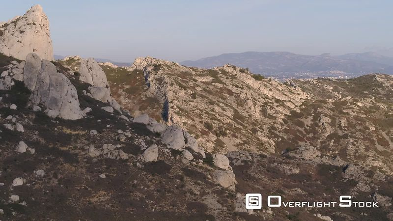 Aerial view of Calanque La Vesse and the Mediterranean Sea with Marseille city in the background , filmed by drone, France