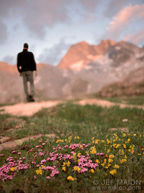 Hiker at sunset in mountain landscape