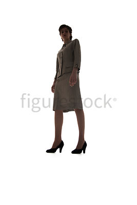 A silhouette of a 1940's /1950's woman in a suit – shot from low-level.