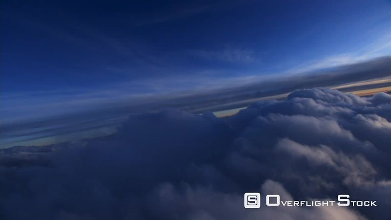 Flying over cumulus clouds at dawn