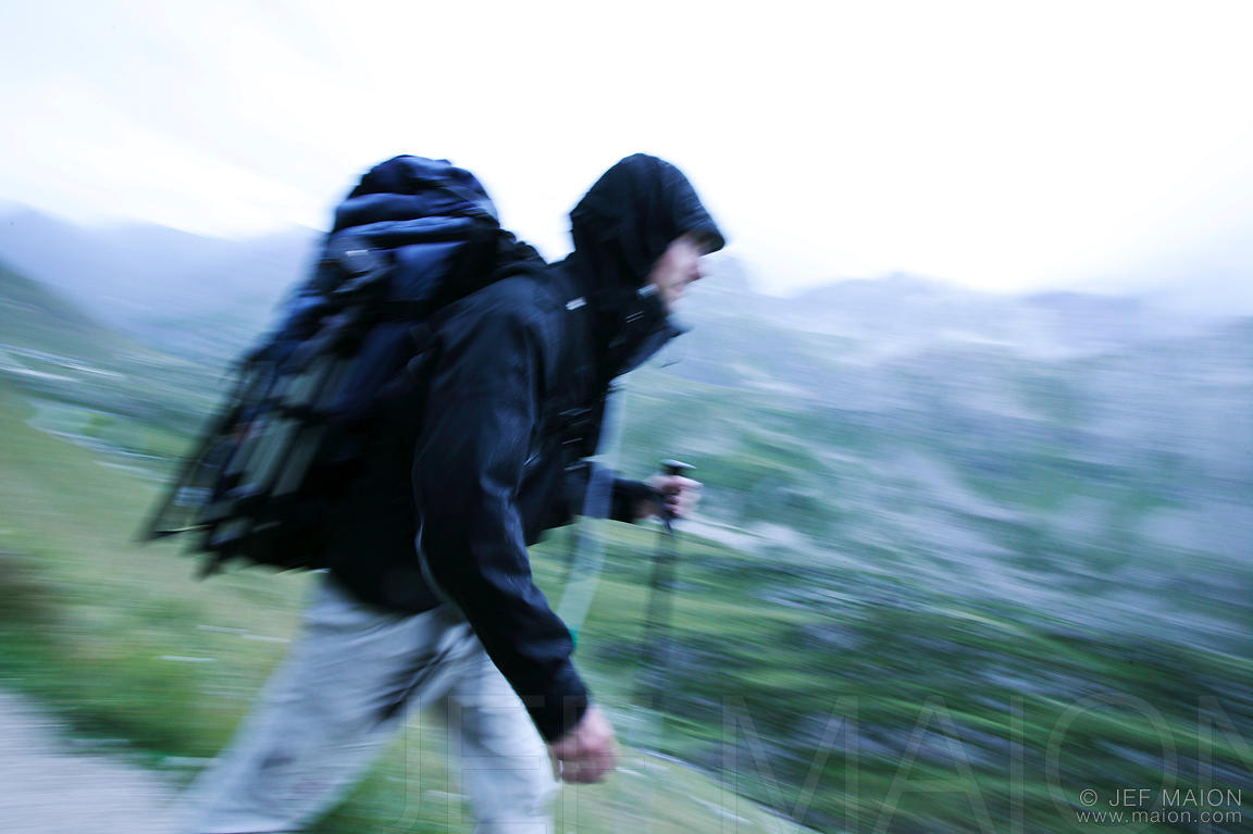 Backpacker walking in rain