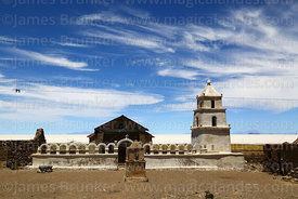Rustic church in village of Chantani, Salar de Uyuni in background, Bolivia