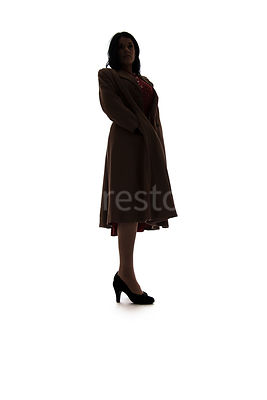 A silhouette of a 1940's woman in a coat – shot from low-level.