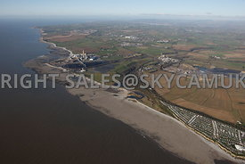 Aberthaw aerial photograph of the geological features caused by the action of the sea showing the beaches and erode volcanic rock shelving and the Aberthaw coal powered power station on the Aberthaw Welsh Coastline
