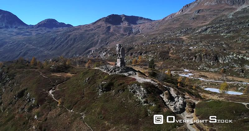 Stone Statue, 4k Aerial Vertigo Effect View of the Eagle Statue Monument, on the Top of Simplon Pass, Sunny Autumn Day, Valais, Switzerland