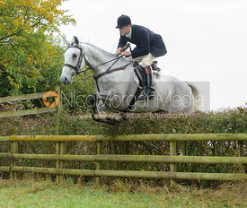 Ollie Finnegan jumping a hedge near Wilson's - The Cottesmore at Langham.