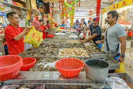 SINGAPORE CITY, SINGAPORE - OCTOBER 08, 2016: Fresh shellfish being sold at a market in Singapore City.