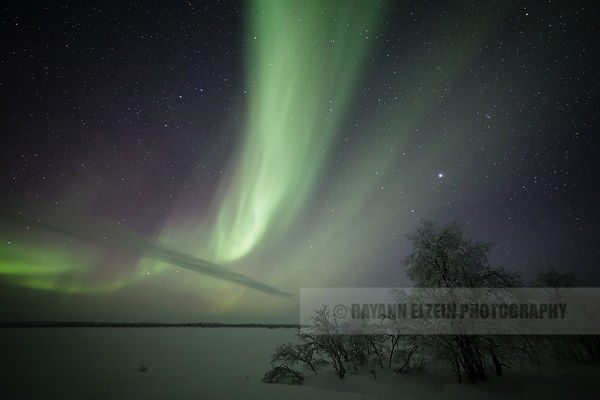 Aurora above the lake in Finnish Lapland