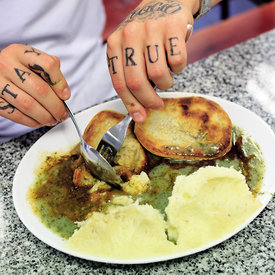 Joe and his tattoos. Robins Pie and Mash shop Southend-On-Sea, Essex.