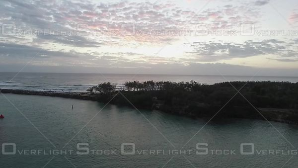 Morning slow pan over river mouth Kingscliffe Australia