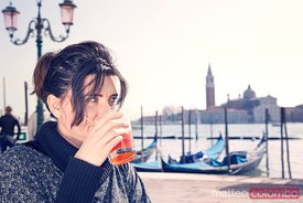 Tourist enjoying an aperitif in Venice