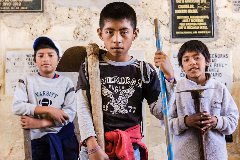 Young Boys Working as Grave Cleaners Before Day of the Dead