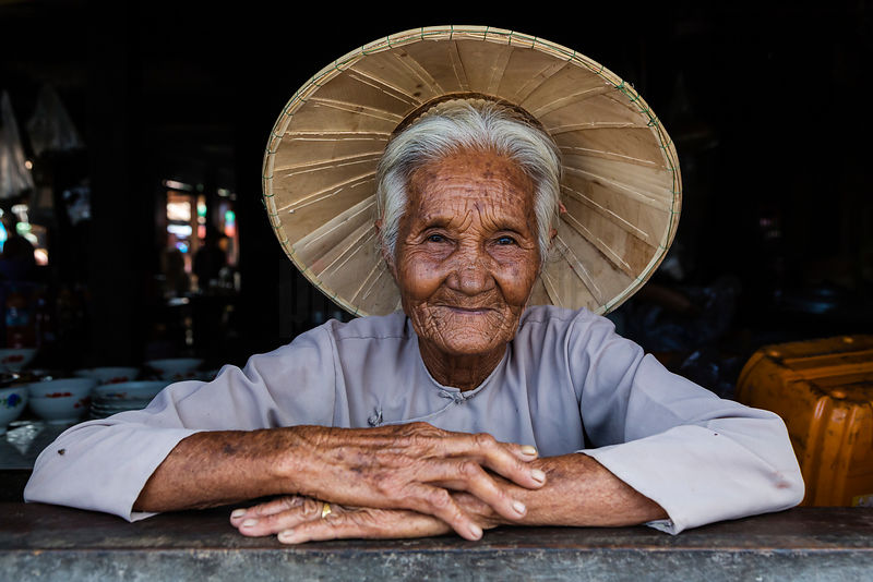 Portrait of an Elderly Woman Wearing a Traditional Hat