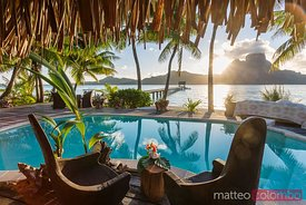 Two chairs at the poolside of luxury hotel, Bora Bora, French Polynesia