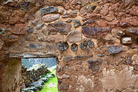 Detail of trapezoid doorway with wooden lintel and beams in wall of  building in Inca site of Pumamarca, Patacancha Valley, Cusco Region, Peru