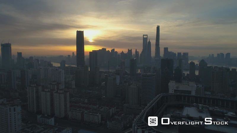 Shanghai Skyline at Sunrise. Aerial View. China. Drone is Flying Forward over The Roof of Skyscraper. Establishing Shot.