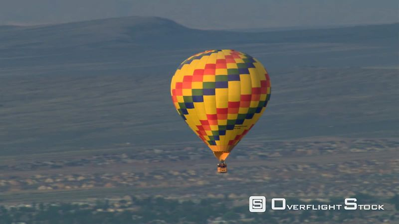 Flight tracking hot air balloon over Albuquerque for close view.